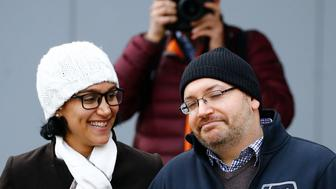 Jason Rezaian, Washington Post reporter and one of the U.S. citizens recently released from detention in Iran, poses to media together with his wife Yeganeh Salehi outside the Emergency Room of the Landstuhl Regional Medical Center (LRMC) in the southwestern town of Landstuhl, Germany, January 20, 2016. Rezaian was one of four American prisoners released by Iran ahead of the lifting of international sanctions on Iran January 16, 2016 as part of a deal between major powers and Iran to curb Tehran's nuclear program.   REUTERS/Kai Pfaffenbach