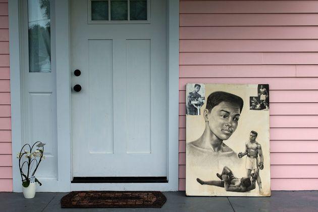 Illustrations depicting Muhammad Ali are seen at the door of hischildhood home in Louisville,