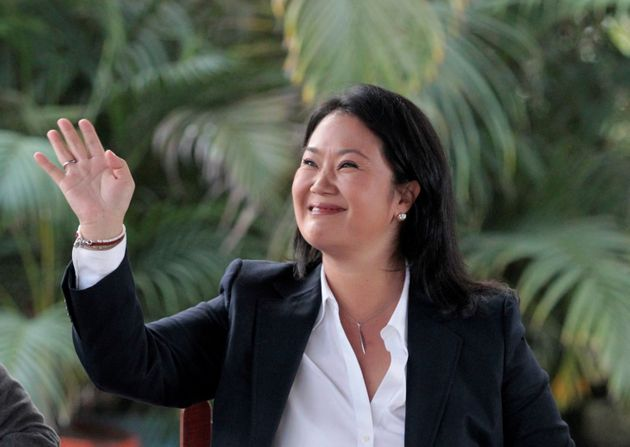 Peruvian presidential candidate Keiko Fujimori waves while arriving for a breakfast meeting in Lima,...