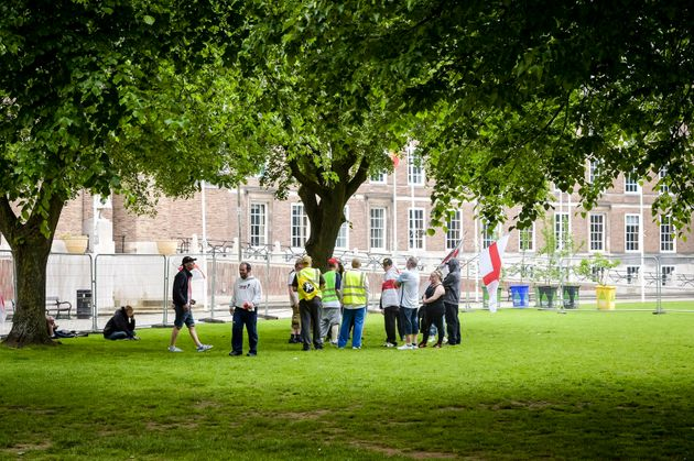 A small group of people attend the far right anti-refugee demonstration at College