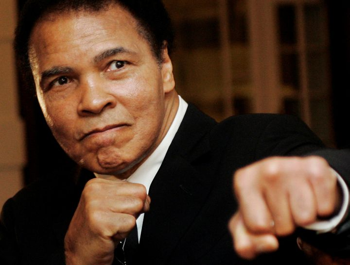 Muhammad Ali poses during the Crystal Award ceremony at the World Economic Forum on January 28, 2006.