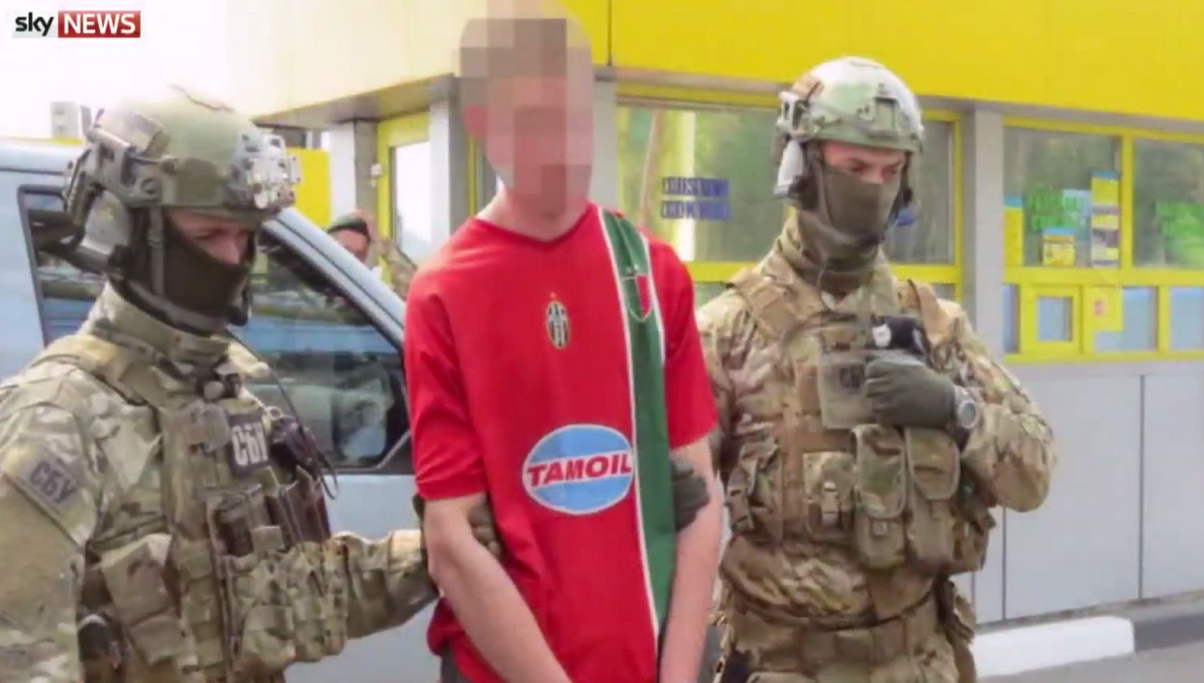 Ukrainian police withGregoire Moutaux who they claim was planning 15 attacks on Euro