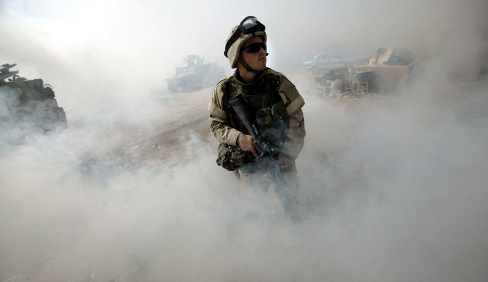 U.S. Army Spc. Jeffrey Ward, a medic with the 1st Cavalry Division, 1st Brigade, 1-12 Cav. from Fort Hood, Texas, stands guar