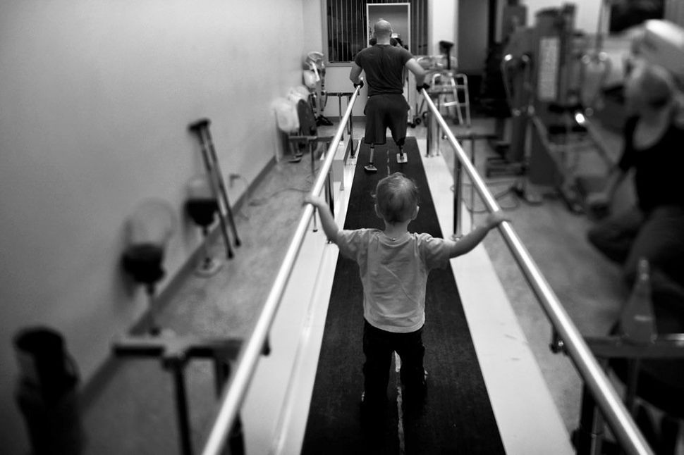 Liam, 2, accompanies his dad, Jake Romo, during rehab at the Naval Medical Center in San Diego. Romo, 22, lost both his legs