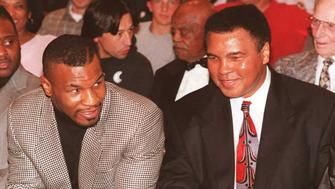 LAS VEGAS, :  Former heavyweight boxing champion Mike Tyson (L) speaks with boxing legend Muhammad Ali, 22 February, at the University of Nevada, Las Vegas (UNLV) student union ballroom. During the evening's program, which kicked-off Black History Month, Ali was honored for the contributions he made to the African-American community. The appearance was arranged by Ali's daughter, Maryum Ali,  who attends UNLV, and the Black Student Association at UNLV.   AFP PHOTO  John GURZINSKI (Photo credit should read JOHN GURZINSKI/AFP/Getty Images)