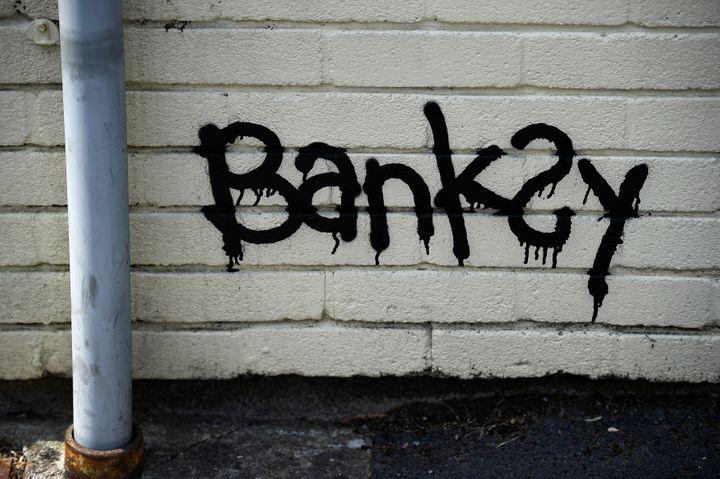 A Banksy signature is seen painted in a bottom corner. The corresponding letter suggested that the students could add to the painting if the school doesn't like it.