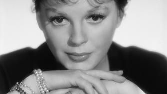 1962:  Judy Garland (Frances Ethel Gumm) (1922 - 1969) in the sixties. Her simple jewellery consists of a wedding and engagement ring and several pearl bracelets on one wrist.  (Photo by John Engstead/John Kobal Foundation/Getty Images)