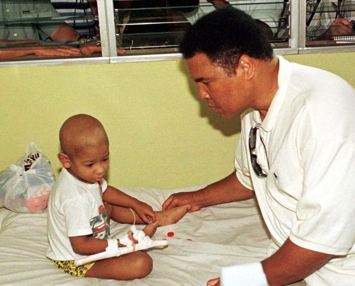Muhammad Ali visits a pediatric hospital in Havana during his trip to Cuba on a humanitarian mission.