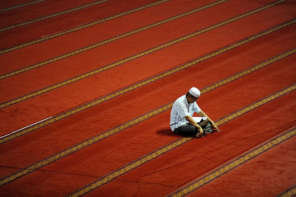 JAKARTA, INDONESIA - JUNE 6: An Indonesian Muslim man reads the Quran during the first day of the fasting month of Ramadan at