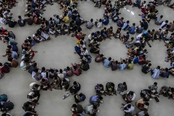 MEDAN, INDONESIA - JUNE 6 : Students from an Islamic boarding school attend a Quranrecitation during Ramadan in a mosqu