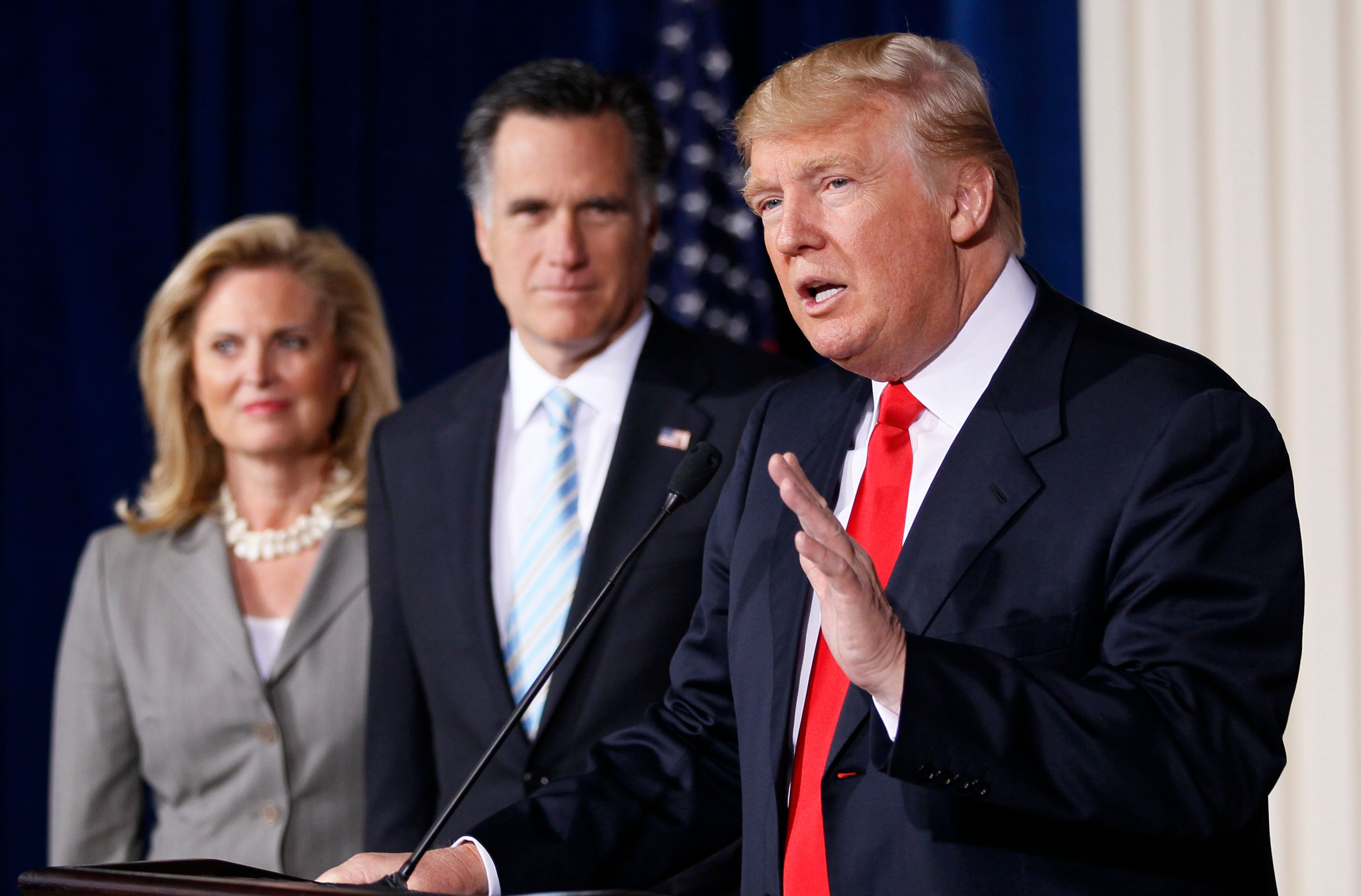 Businessman and real estate developer Donald Trump (R) endorses U.S. Republican presidential candidate and former Massachusetts Governor Mitt Romney's candidacy for president as Romney and his wife Ann look on at the Trump Hotel in Las Vegas, Nevada February 2, 2012. REUTERS/Rick Wilking (UNITED STATES  - Tags: POLITICS ELECTIONS BUSINESS)