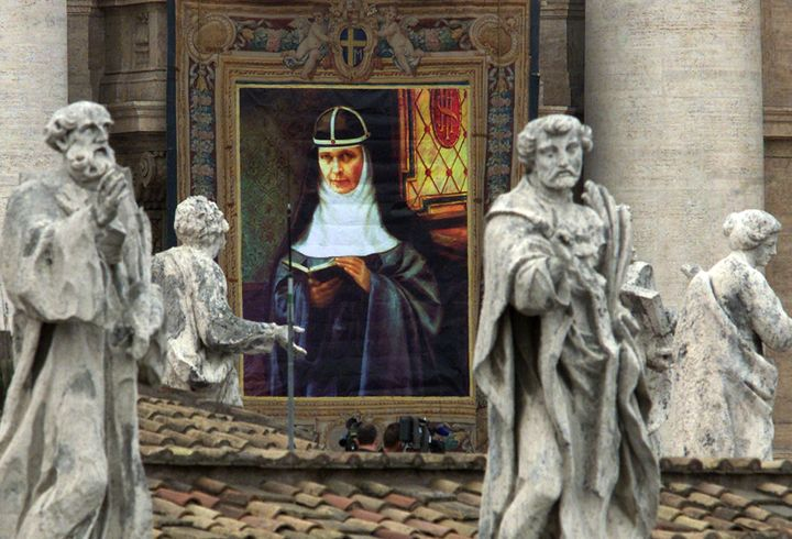 The portrait of Sweden's Maria Elisabeth Hesselblad (1870-1957), who gave refuge to Jews in her homeland during World War Two, is hung on St. Peter's facade behind other Saint's statues during her beatification ceremony in Vatican April 9.