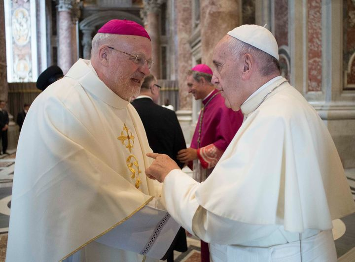 Pope Francis meets Bishop of Stockholm, Anders Arborelius (L) before he leads the mass for the canonization of Swedish nun Si