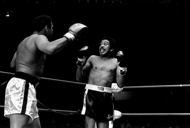 Richard Pryor appears scared to death as he is shown facing Muhammad Ali in a benefit fight at the Olympic Auditorium, Los An