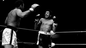 Richard Pryor appears scared to death as he is shown facing Muhammad Ali in a benefit fight at the Olympic Auditorium, Los Angeles, California, May 8, 1978. Ali was helping Howard Bingham, his former photographer, who is running for the 31st District Congressional office. (AP Photo/Jeff Robbins)