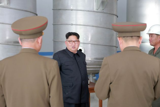 North Korean leader Kim Jong Un visits the construction site of a soap factory in this undated photo...