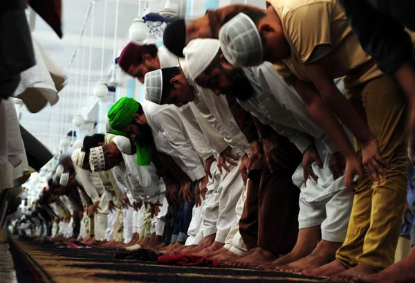 "Pakistani Muslims perform a special ""Tarawih"" evening prayer on the first day of the Muslim fasting month of Ramadan at a mos"