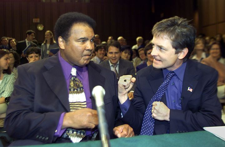 Boxing legend Muhammad Ali and actor Michael J. Fox talk before the start of a Senate subcommittee on Labor, Health, Human Se