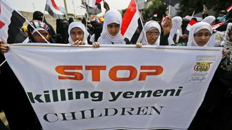 Girls demonstrate against the Saudi-led coalition outside the offices of the United Nations in Yemen's capital Sanaa August 11, 2015. A political crisis descended into civil war in March when Iranian-allied Houthi forces who had seized the capital Sanaa advanced south towards the main port of Aden, forcing President Abd-Rabbu Mansour Hadi to flee to Saudi Arabia. A Saudi-led Arab military coalition began a bombing campaign against the Houthis on March 26 to restore Hadi and fend off what they see as Iranian influence. Houthi forces have since been pushed back on several fronts. REUTERS/Khaled Abdullah