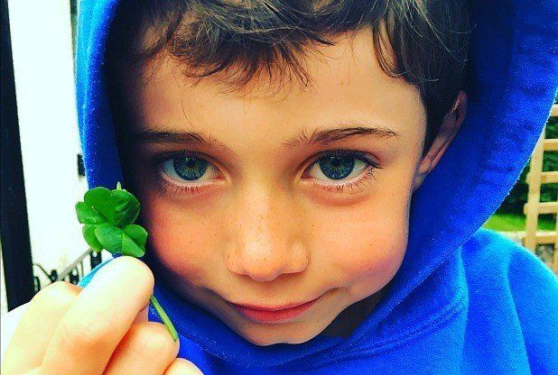 Archie Morgan holding his five-leaf clover