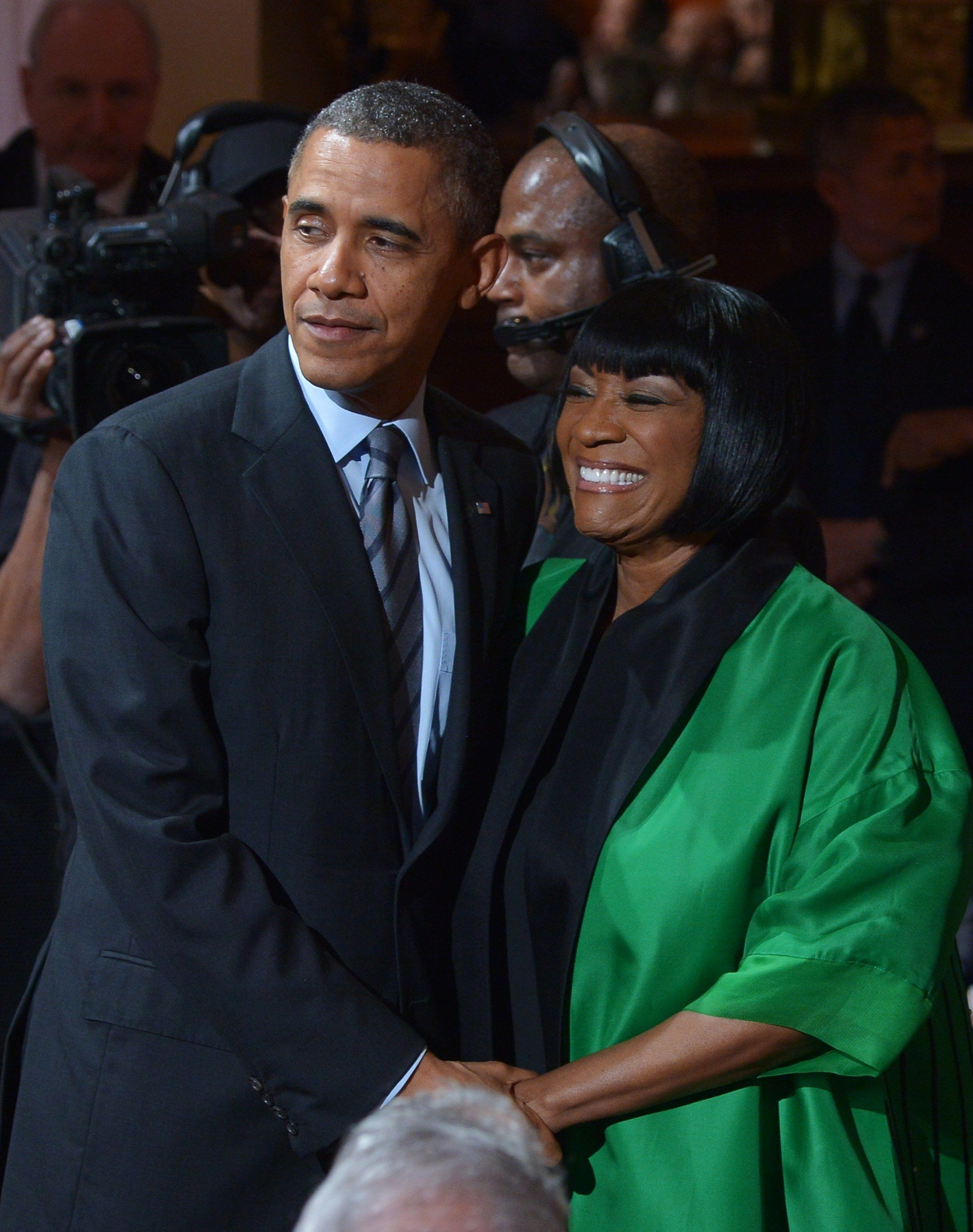 US President Barack Obama chats with singer Patti LaBelle (R) before she arrived on stage at the In Performance at the White House: Women of Soul in the East Room of the White House on March 6, 2014 in Washington, DC. AFP PHOTO/Mandel NGAN        (Photo credit should read MANDEL NGAN/AFP/Getty Images)