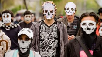 People wearing masks of skulls protest against violence in the country, in Mexico City on November 27, 2011. More than 40.000 people have been killed in rising drug-related violence in Mexico since December 2006, when President Felipe Calderon deployed soldiers and federal police to take on organized crime. AFP PHOTO/Alfredo Estrella (Photo credit should read ALFREDO ESTRELLA/AFP/Getty Images)
