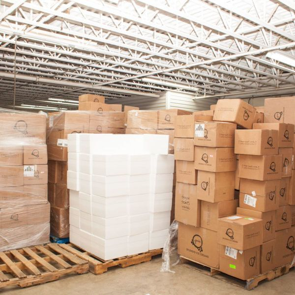 A stack of coolers and boxes at Jeni's warehouse.