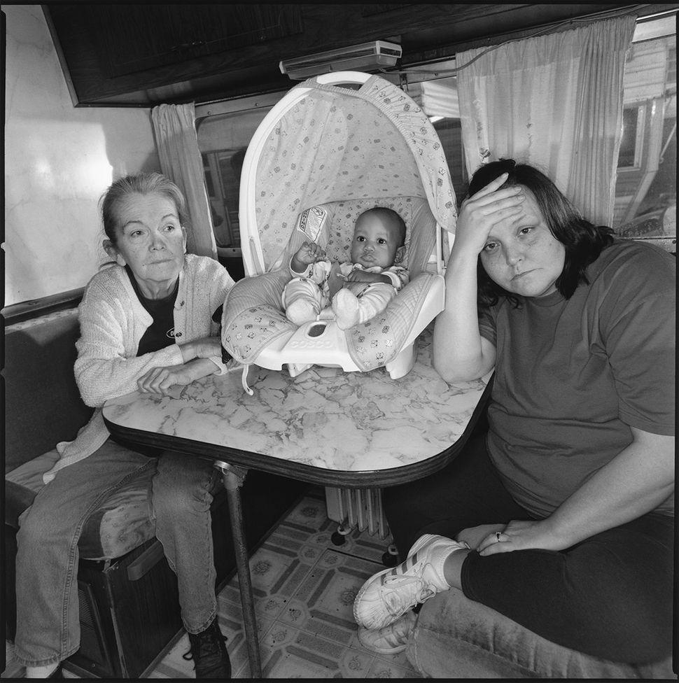 Pat, Julian, and Tiny in Pat's trailer, 2003
