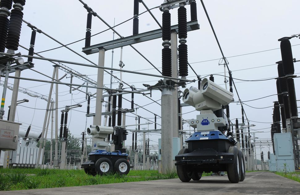 Two robots inspect equipment at a power substation in Chuzhou, China.