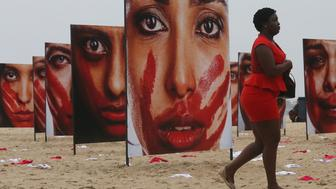 RIO DE JANEIRO, BRAZIL - JUNE 06:  Photographs by Marcio Freitas of models portraying women who are abused are displayed on Copacabana beach with 420 pairs of underwear at a demonstration against violence against females on June 6, 2016 in Rio de Janeiro, Brazil. The demonstration was put on by the NGO Rio de Paz who said the 420 pairs of underwear represent the number of women raped in Brazil every 72 hours. The protest follows the gang rape of a 16-year-old girl in late May in Rio de Janeiro. The Rio 2016 Olympic Games begin August 5.  (Photo by Mario Tama/Getty Images)