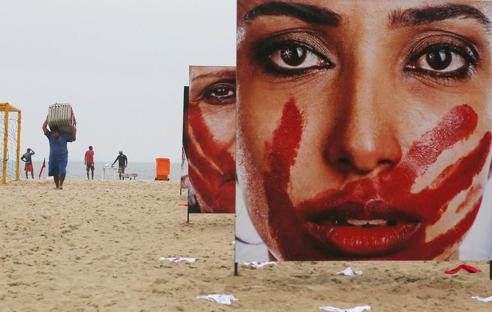 Monday's protest on Copacabana beach in Rio de Janeiro follows the widely publicized gang rape of a 16-year-old girl in