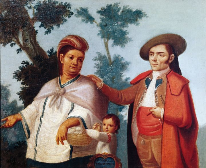 This Mexican painting portrays a mixed race family with their Mestizo child.