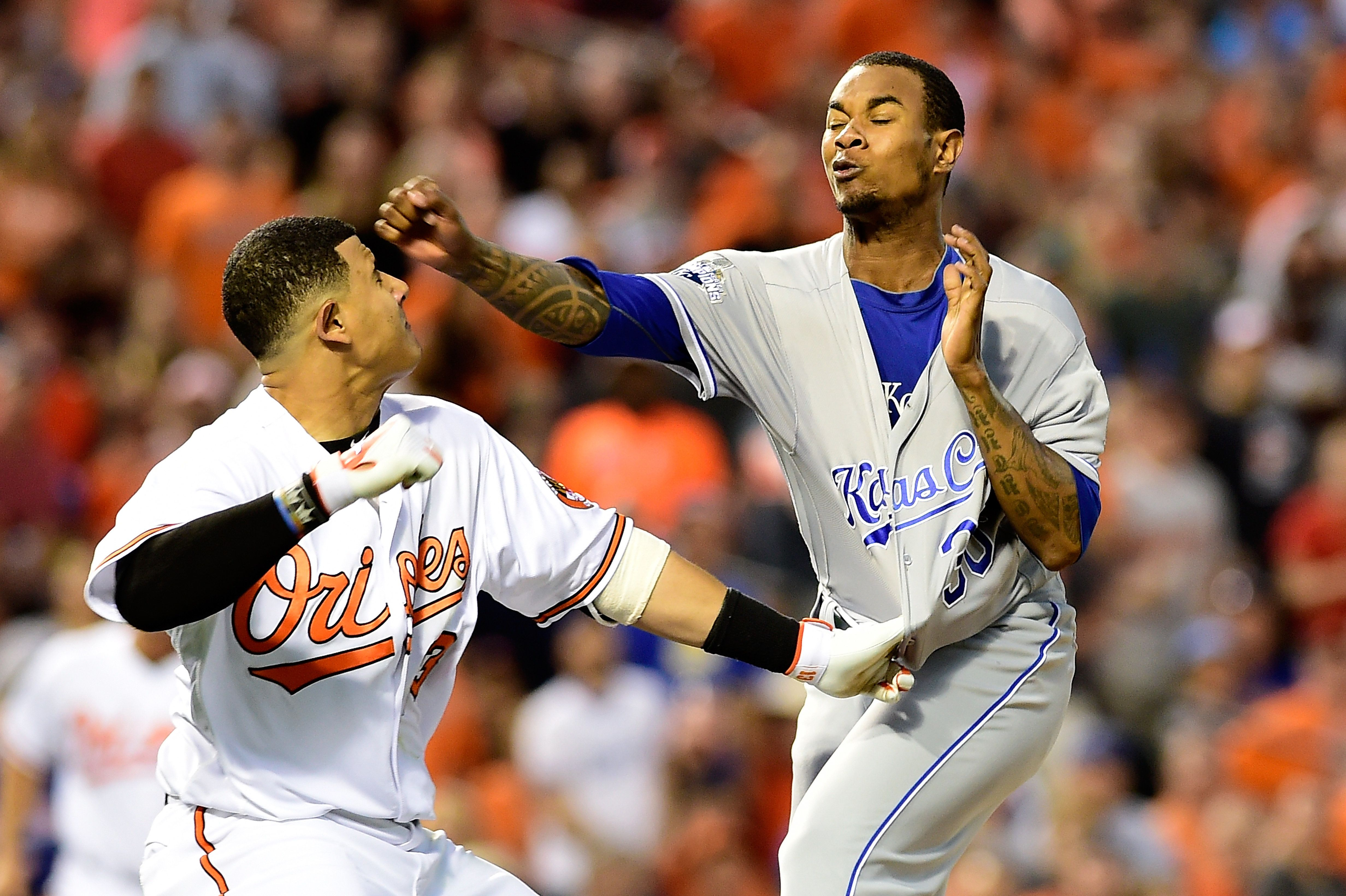BALTIMORE, MD - JUNE 07:  Manny Machado #13 of the Baltimore Orioles and Yordano Ventura #30 of the Kansas City Royals fight in the fifth inning during a MLB baseball game at Oriole Park at Camden Yards on June 7, 2016 in Baltimore, Maryland. Machado and Ventura were ejected from the game. (Photo by Patrick McDermott/Getty Images)