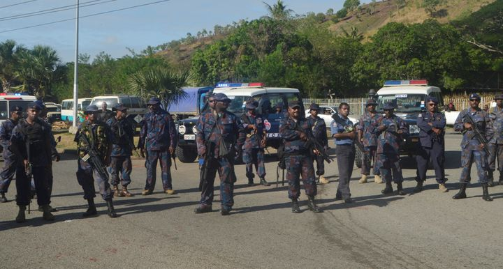 Heavily-armed Papua New Guinea police form a roadblock, preventing students from leaving the University of Papua New Guinea i