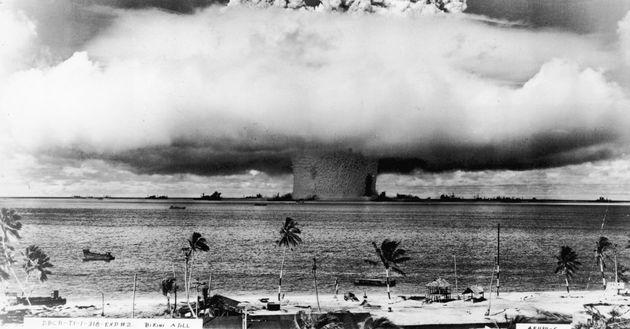 An atomic bomb explodes on Bikini Atoll in