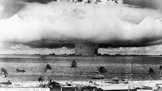 25th July 1946:  View of a mushroom cloud from a US atomic test explosion rising over the Marshall Islands from the Bikini Atoll in the Pacific Ocean.  (Photo by American Stock/Getty Images)