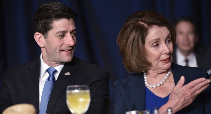 House Speaker Paul Ryan chats with House Minority Leader Nancy Pelosi during the National Prayer Breakfast on February 4, 201