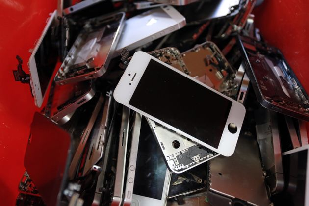A picture taken Nov. 7, 2014, in Brive, southern France, shows smartphone screens in the Love2recycle.fr...