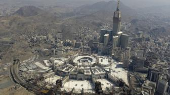 MECCA, SAUDI ARABIA - SEPTEMBER 25: An aerial view shows the Clock Tower and the Grand Mosque in Saudi Arabia's holy Muslim city of Mecca on September 25, 2015. (Photo by Ozkan Bilgin/Anadolu Agency/Getty Images)