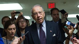 WASHINGTON, DC - MAY 9: Sen. Chuck Grassley (R-IA)  speaks with reporters on his way to a vote at the U.S. Capitol, May 9, 2016, in Washington, DC. Senate Democrats defeated a procedural vote on an energy bill, which increases funding for the Department of Energy and Army Corps of Engineers. (Photo by Drew Angerer/Getty Images)