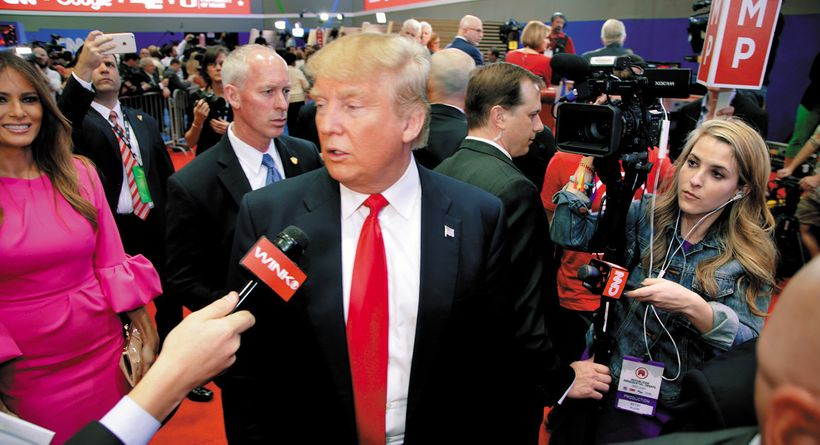 Trump being interveiwed amid a swarm of media after a March 10 GOP debate in Miami