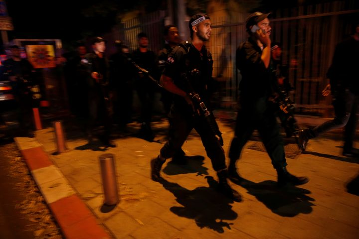 Israel security forces search the area following a shooting attack in the center of Tel Aviv on Wednesday.