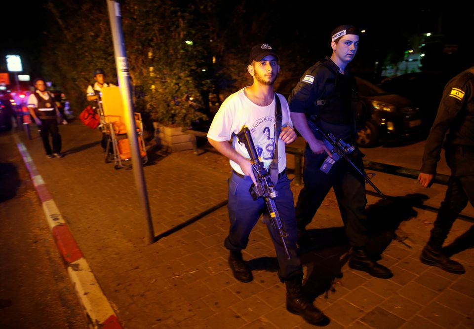 Gunmen opened fire near Israel's military headquarters in central Tel Aviv on June 8, 2016. Israeli security perso
