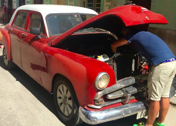One of the many vintage cars Cubans keep running through decades.