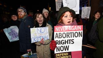 BELFAST, NORTHERN IRELAND - JANUARY 15:  Pro Choice activists rally outside City Hall on January 15, 2016 in Belfast, Northern Ireland. The Pro Choice activists are rallying in support of the 21 year old woman, who cannot be identified for legal reasons, charged this week at Belfast Magistrates' court with unlawfully administering to herself noxious substances, namely the drugs Mifepristone and Misoprostol with intent to procure a miscrriage for herself. Abortion in Northern Ireland is still unlawful despite a recent High Court ruling that in some circumstances the current laws were a breach of human rights.  (Photo by Charles McQuillan/Getty Images)