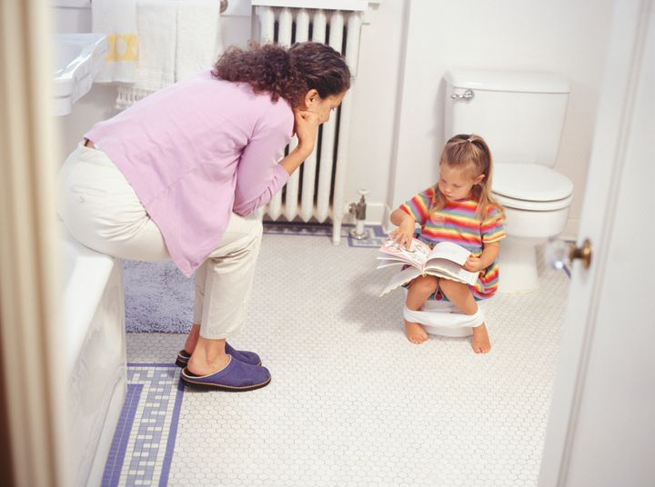 <p>Mother potty training daughter</p>