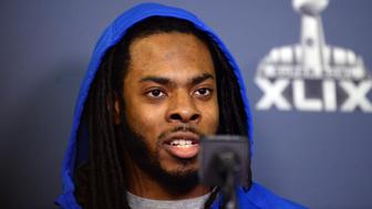 Jan 25, 2015; Phoenix, AZ, USA; Seattle Seahawks cornerback Richard Sherman fields and answers questions during at press conference at the Arizona Grand Hotel in preparation for Super Bowl XLIX. at Arizona Grand Hotel. Mandatory Credit: Joe Camporeale-USA TODAY Sports