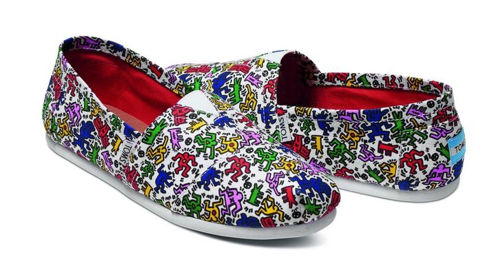 The new footwear features Haring's signature squiggles and stick figures.