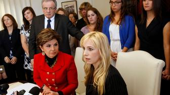 Attorney Gloria Allred, left sitting and Dr. Caroline Heldman, professor of politics, along with 6 sexual assault victims at a news conference to announce the filing of a complaint against Occidental as a result of what the women allege is the college's 'Deliberate indifference to rape victims.' .  (Photo by Irfan Khan/Los Angeles Times via Getty Images)