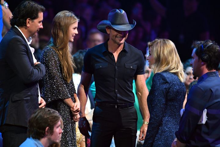 The two were spotted chatting with CMTs co-host, Erin Andrews.